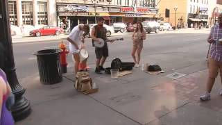 Street Performers vs. Panhandlers: Both are Playing Music Downtown