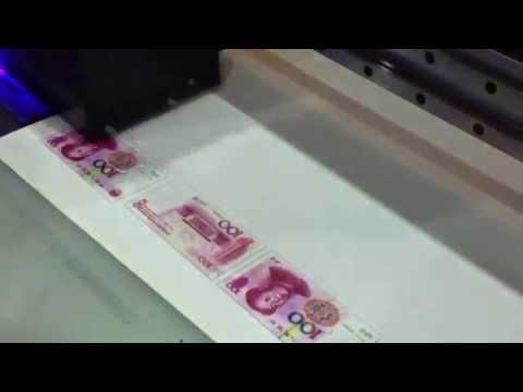 UV flatbed printer, A1 size printer, UV printing China Curreny CNY on leather