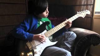 "9 year old kid plays ""Eruption"" guitar solo by Van Halen"