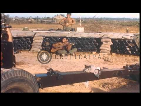US Army 1st Infantry Division soldiers work on a 105 mm howitzer during their com...HD Stock Footage