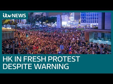 New Hong Kong protests as China moves armed vehicles to border | ITV News
