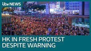 New Hong Kong protests as China moves armed vehicles to border | ITV News
