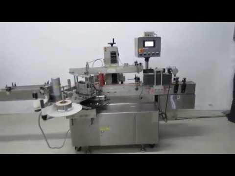 CLI wrap around labeler model UNI-500 with overhead for panel labeling
