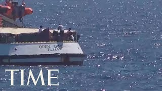 At Least 15 Migrants Jump Off Rescue Ship In 'Desperate' Attempt To Reach Italy   TIME