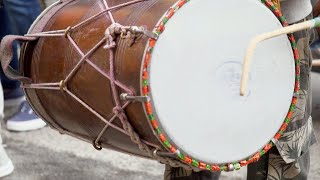 Closeup shot of drummer's hands playing drum during sangeet and mehndi party - Indian wedding