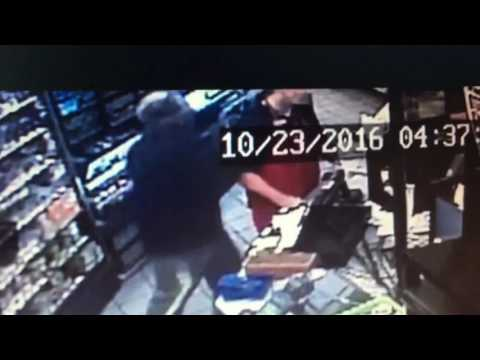 Store clerk punched in the face while being held at gunpoint