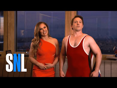 "Thumbnail: SNL Host Ronda Rousey Lets Beck ""The Wreck"" Bennett Try His Noggin Lock"