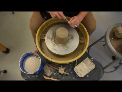 Trimming a cup or mug form. Ceramics I. Ms. Greninger. NCS-PFAA.