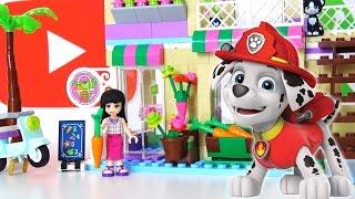 Маршал из команды Щенячий Патруль помогает Майе и Мие в магазине Лего Френдс