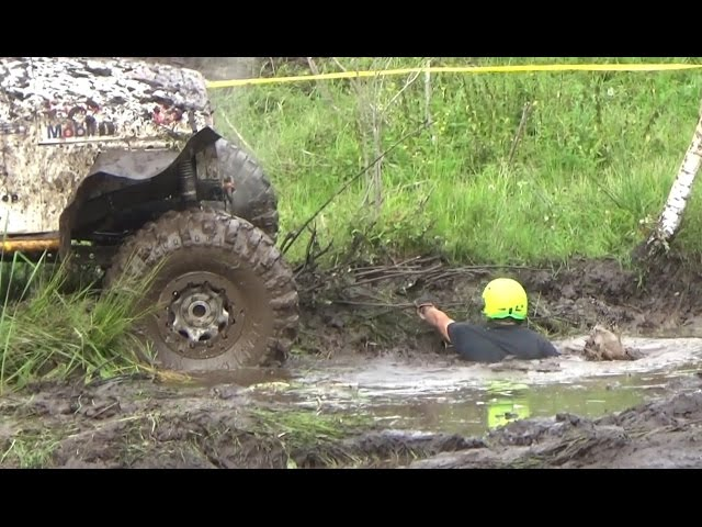 Off-Road vehicles in mud puddle