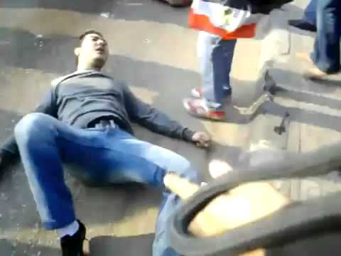 Egyptian protesters in Alexandria fall off crowd control water truck as it sprays the people.