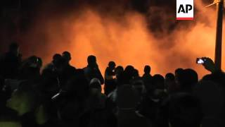 Protesters clash with riot police outside presidential palace Alexandria protest