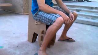 16 Ounce Cardboard Chair Holding A 200 +- Kid
