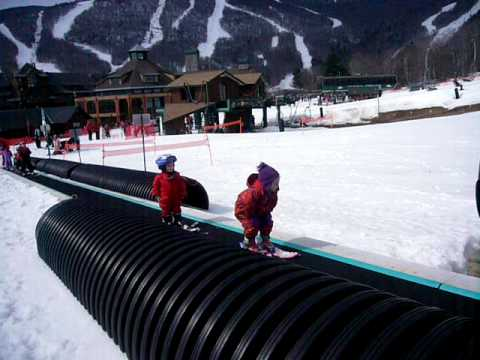 Kids skiing on magic carpet at Stowe