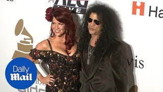 Slash and Perla Ferrer appearing together in 2009 - Daily Mail