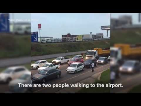 OR Tambo chaos as metered taxis block highway
