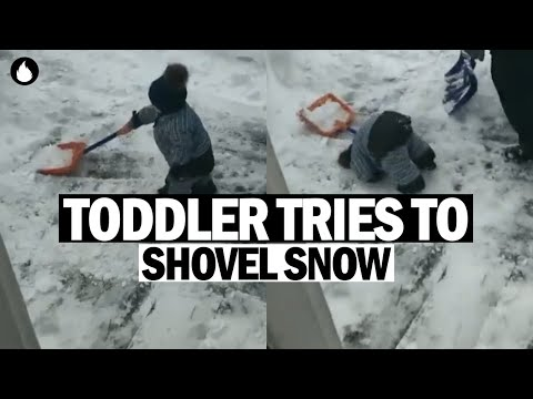 Kid Shovels Snow With His Father!