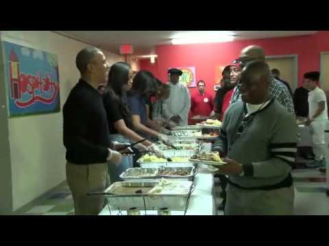 President Barack Obama serves Thanksgiving dinner at a homeless center in Washington, D.C.