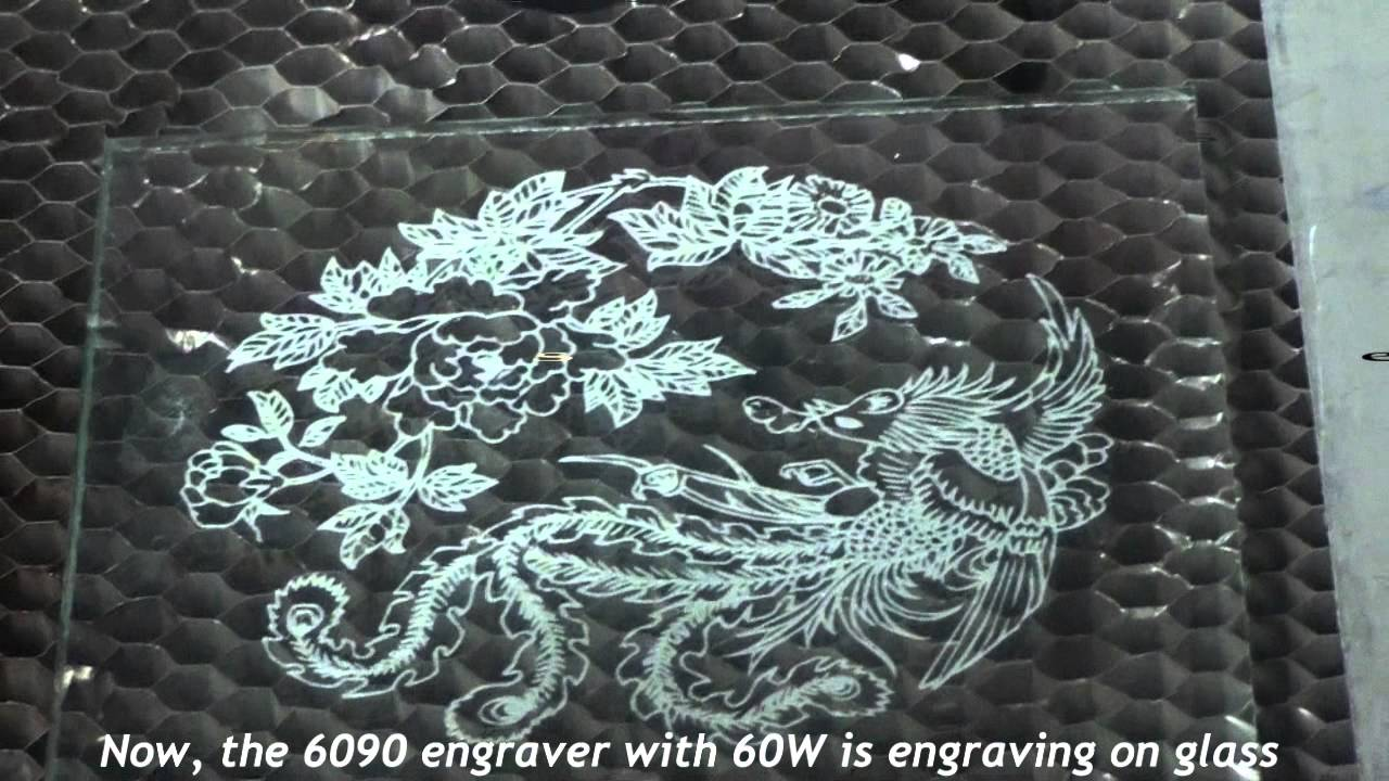 Laser Engraving Machine Working On Glass And Jeans Youtube