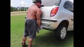 Strong man lifting a car