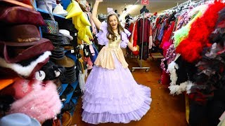 trying on disney princess dresses