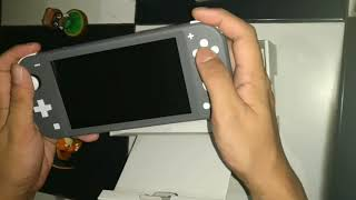 Nintendo Switch Lite and Resident Evil Triple Pack Unboxing