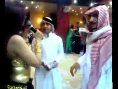 Sheikh throwing money on bellly dancer in a UAE Nightclub
