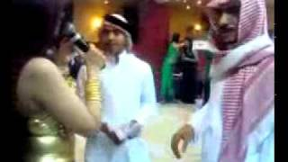 Sheikh throwing money on bellly dancer in a UAE Nightclub