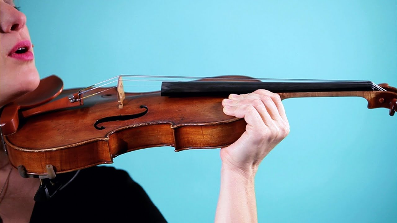 Violin hand on shoulder of violin