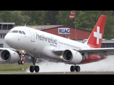 Airbus A319 Helvetic Airways Take Off on Wet Runway at Bern Airport