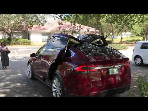 Tesla model X with all the doors open at our  office