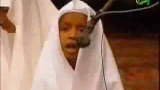 a boy Reciting Quran beutiful way ( cajiib cod qurux badan)