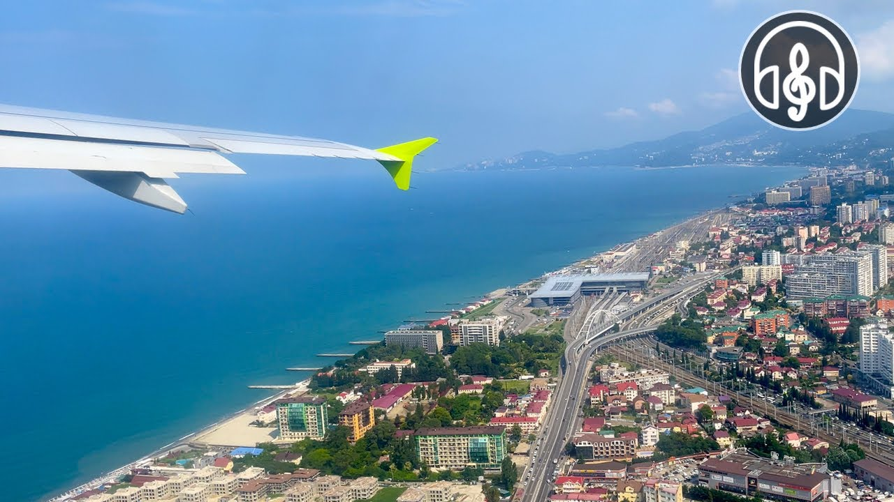 Take-off of the plane with a view of the Black Sea. Sound of an airplane engine.