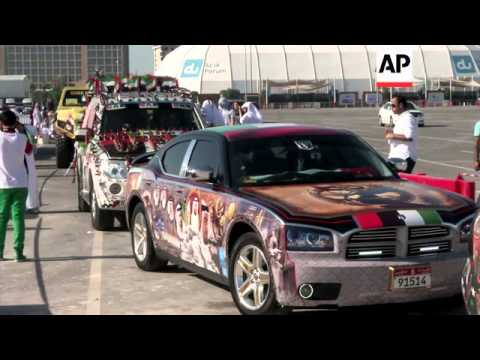 Hundreds of drivers take part in decorated car parade for National Day