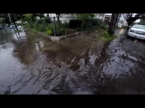 Localized street flooding in Somerville, MA 07/12/2017 - Clearing the storm drains of debris