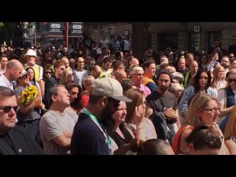 Manchester crowd sing Oasis song after minute's silence