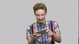 emotional boy playing game on smartphone expressive