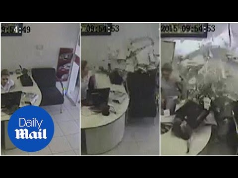 CCTV captures moment truck crashes into office worker's desk - Daily Mail