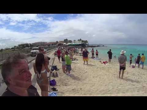 St. Maarten takeoffs, landings & Smokin' chick in bikini