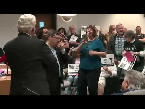 Bill Akins booed after 'death panel' comment Town hall Florida