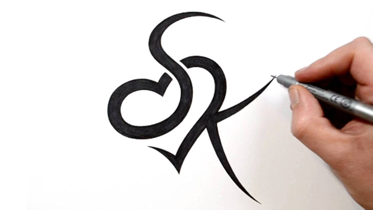 Combining Initials S And K With A Heart Tattoo Design