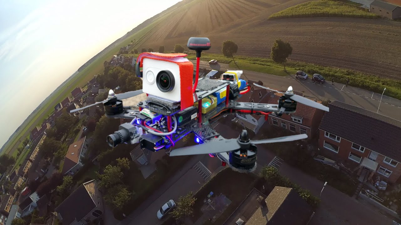 Racing Drone 250 Flying Fast Over Houses