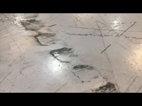 Cleaning epoxy resin floor of a warehouse