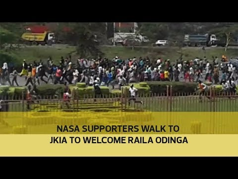 Nasa supporters walk to JKIA to welcome Raila Odinga