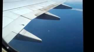 Flying as seen from inside a plane using a mobile phone.