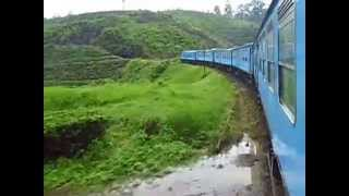 Travel on Train in Sri Lanka - Udarata Manike train going through tea plantation on cool hill top.
