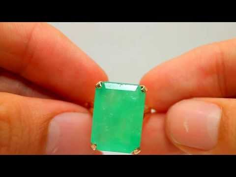 classic four prong emerald ring