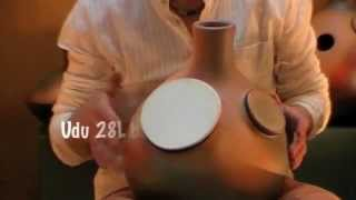 Play an udu two skins