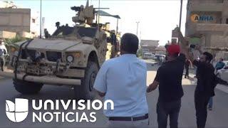 """""""¡Estadounidenses mentirosos!"""": civiles sirios arrojan papas a los soldados de EEUU que se retiran d"""