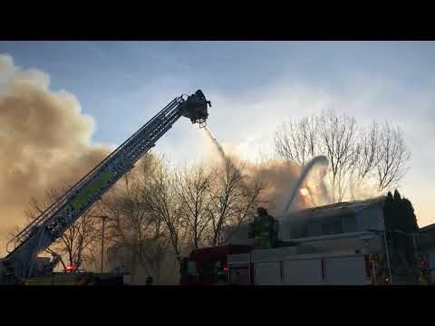 West Fargo fire destroys two homes, damages another | Crowds and cars became major obstacles